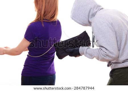 Thief steals woman's purse - stock photo