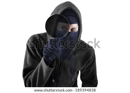 Thief using magnifying for looking information. isolated on white background