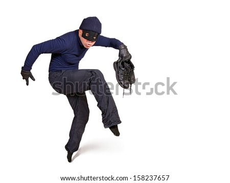 thief walking on tiptoe. Burglar with a mask on his face walking quietly isolated on a white background. Robber in dark clothes careful walks on tiptoe. Thief is trying move silently tip-toe.