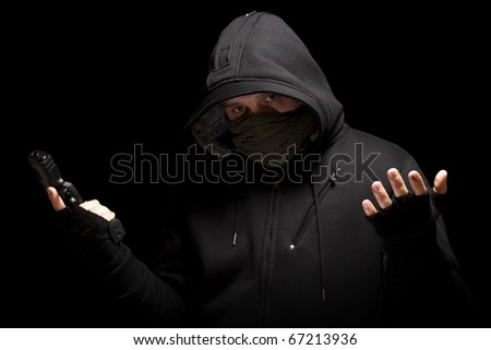 Thief with gun - isolated on black background - stock photo
