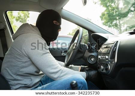 Thief With Mask Trying To Steal A Car