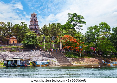 Thien Mu pagoda with Perfume River (Song Huong) in Hue, Vietnam. Hue is recognized as a World Heritage Site by UNESCO. - stock photo