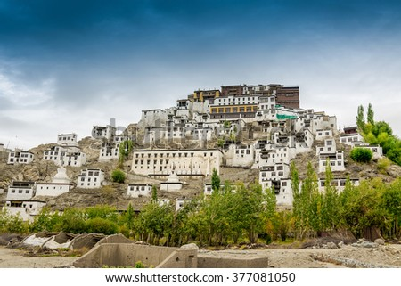 Thiksay monastery with view of Himalayan mountians and blue sky in the background - it is a famous Buddhist temple in,Leh, Ladakh, Jammu and Kashmir, India. - stock photo