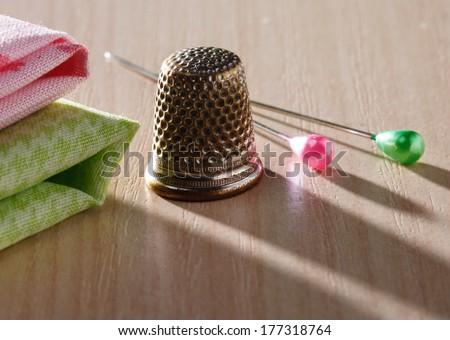 Thimble and pins - stock photo