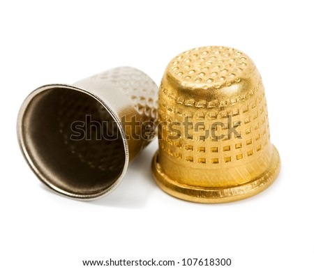 Thimble gold and silver isolated on white background - stock photo