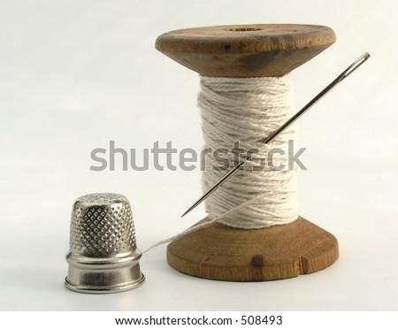 thimble, needle and thread - stock photo