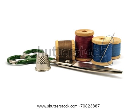 thimble, needle, scissors and threads on white background - stock photo