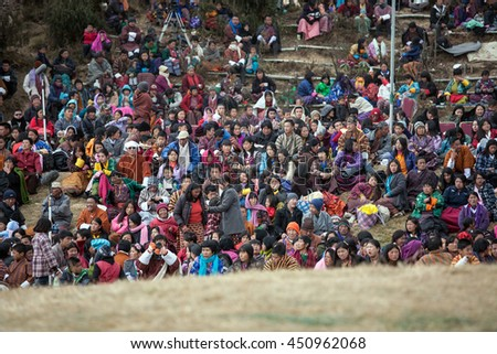 THIMPHU, BHUTAN - DECEMBER 13: Unidentified Bhutan peoples visit Tshechu Festival. It's yearly festival show the traditional mask story about buddhism culture on December 13, 2012 in Bhutan