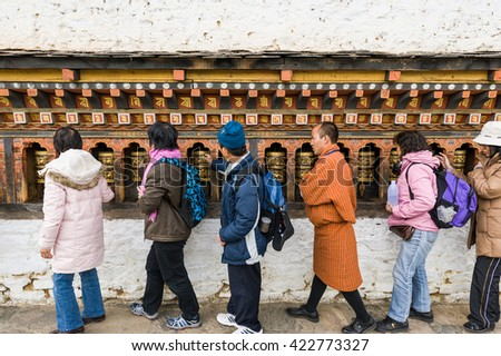 Thimphu, Bhutan, 02 Nov 2011: Tourists turning prayer wheels at Changangkha Lhakang, the oldest monastery in Bhutan.