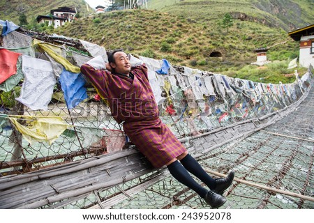 THIMPHU,BHUTAN -SEPTEMBER 22:Bhutanese lay down on the bridge on September 22,2012 in Thimphu,Bhutan