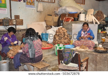 Thimpu, Bhutan- March 10, 2015: women working with pulp to handmake paper