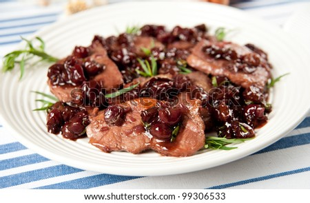 Thin Cut Pork Chops Cooked With Grapes And In Red Wine Sauce