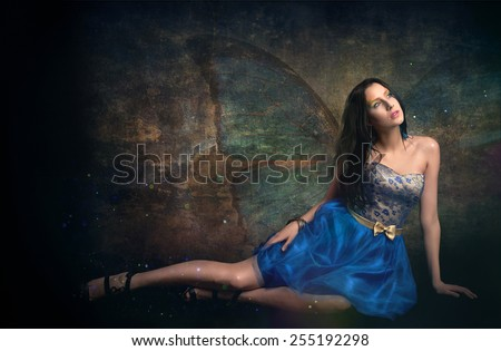 Thin Girl In Blue Dress With Butterfly Wings On Grunge Background  - stock photo