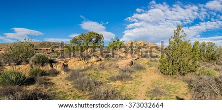 Thin line of a hiking trail through the wilderness of the Mojave desert in southwest United States. - stock photo