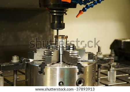 Thin mill cutting the metall blank in vertical chuck - stock photo