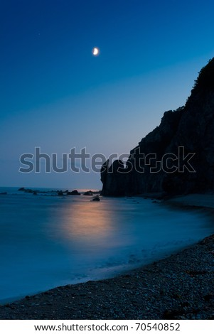 Thin month over the surf - stock photo