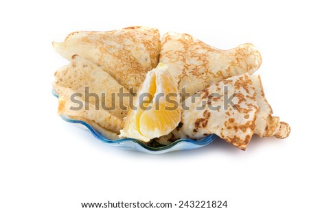 Thin pancakes with an orange lobule are isolated on a white background