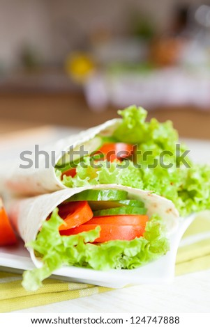 thin pita bread and a salad of fresh vegetables, food closeup - stock photo