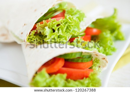 Thin pita bread and fresh vegetables, close up - stock photo
