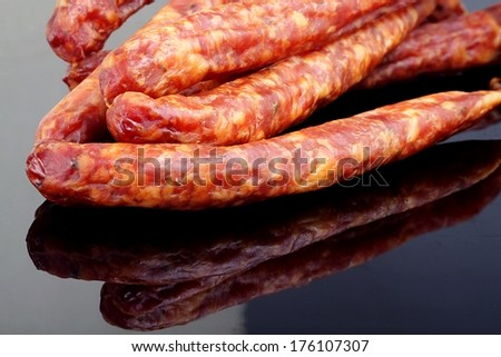 thin sausage on a black background
