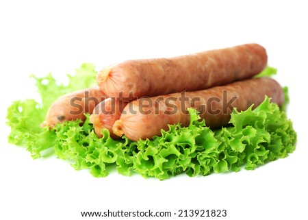 Thin sausages  with lettuce salad leaves, isolated on white
