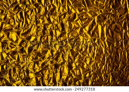 Thin sheet , leaf background with shiny crumpled uneven surface
