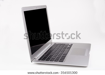 Thin silver laptop side view with black screen and keyboard reflection in the screen isolated on white background - stock photo