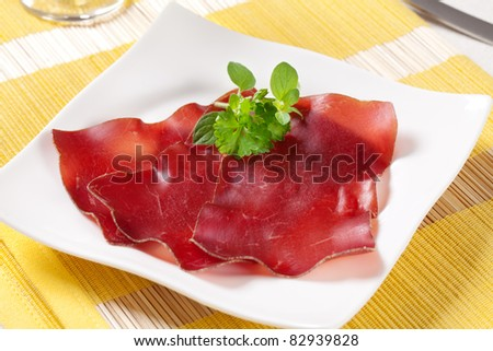 Thin slices of dry cured ham - stock photo