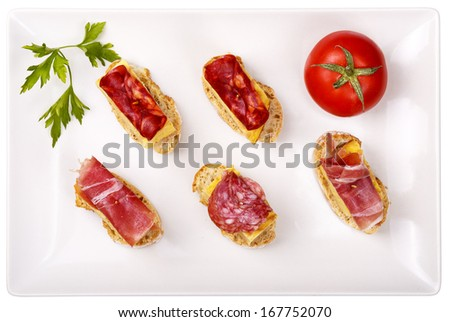 thin slices of Iberian sausage omelette with bread on white base - stock photo