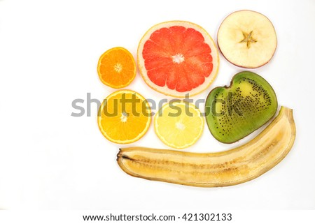 thin slicing different fruits on white background