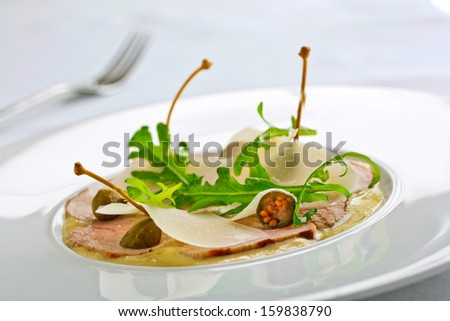 thin veal slices with tuna sauce - stock photo