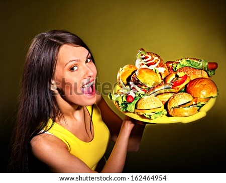 Thin woman holding group hamburger. - stock photo
