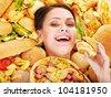 Thin woman holding hamburger. - stock photo