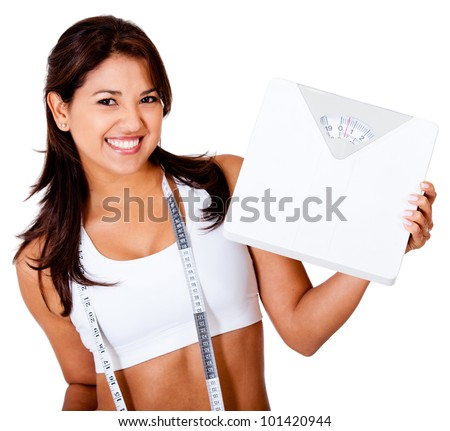 Thin woman loosing weight and holding a scale - isolated over white - stock photo