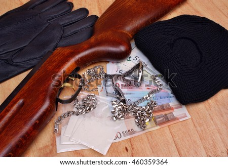 Things bandit criminal drug dealer gun, balaclava, gloves euro money on the table - stock photo