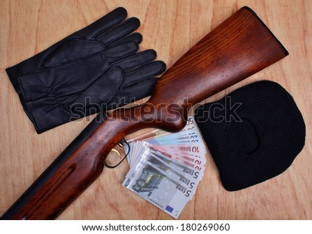 Things bandit criminal gun, balaclava, gloves, euro money  on the table - stock photo