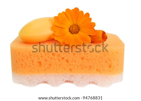 Things for body care with beautiful marigold flower - on white background
