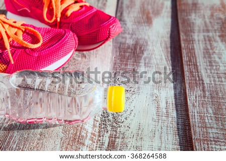 things for sport are isolated on a wooden background - stock photo