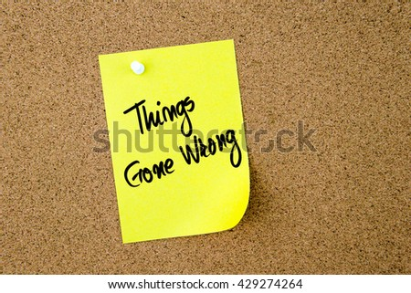 Things Gone Wrong written on yellow paper note pinned on cork board with white thumbtack, copy space available - stock photo