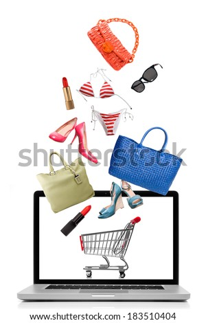 Things to buy falling into notebook isolated on white. Shopping concept - stock photo