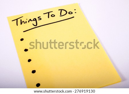 Things to Do written on a piece of Note Paper. - stock photo