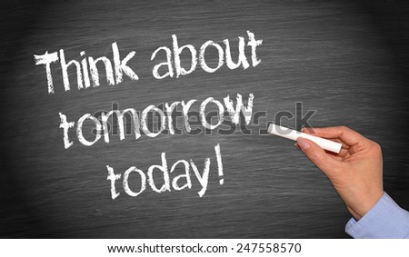 Think about tomorrow today ! - Female hand writing text on blackboard - stock photo