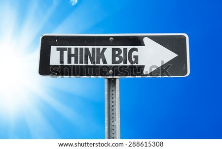 Think Big direction sign with a beautiful day - stock photo