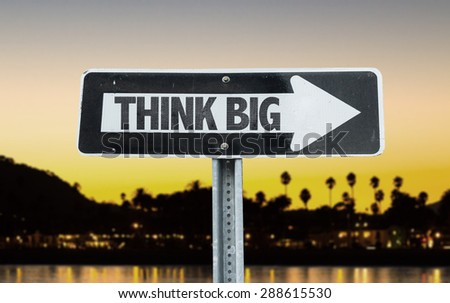 Think Big direction sign with sunset background - stock photo