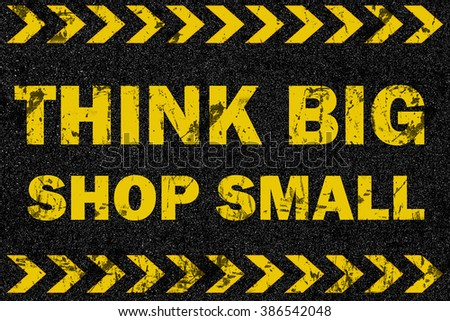 Think big shop small word on grunge background