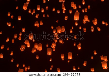 Think Floating lantern, Yee Peng Festival in the sky at Chiangmai, Thailand. (The current ban on releasing Yi Peng Lantern in five districts near the airport. Due to fear a danger to the aircraft).