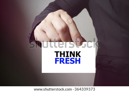 THINK FRESH paper on the card , business concept , business idea