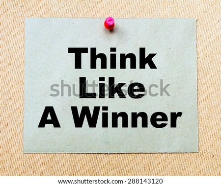 Think Like a Winner written on paper note pinned with red thumbtack on wooden board. Business conceptual Image - stock photo