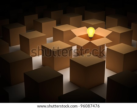 Think outside the box and individuality concept, one glowing light bulb over opened cardboard box - stock photo