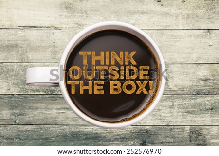 think outside the box! coffee cup with wood background - stock photo